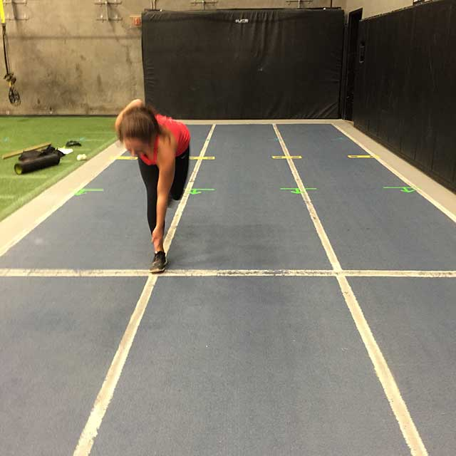 Image of woman doing a sideway hop exercise with Laura Coleman