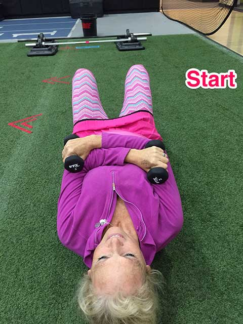 Image of Laura Coleman demonstrating the hot cross buns exercise for shoulders and abs start