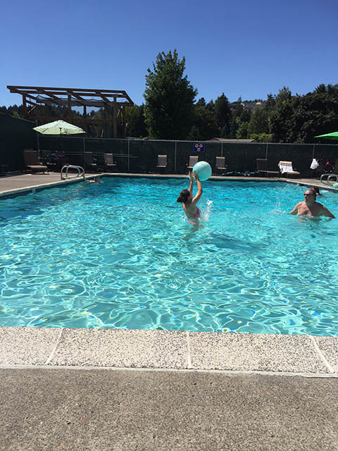 Image of two people throwing a ball in a pool