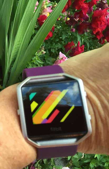 image of a fitness tracker on someone's wrist