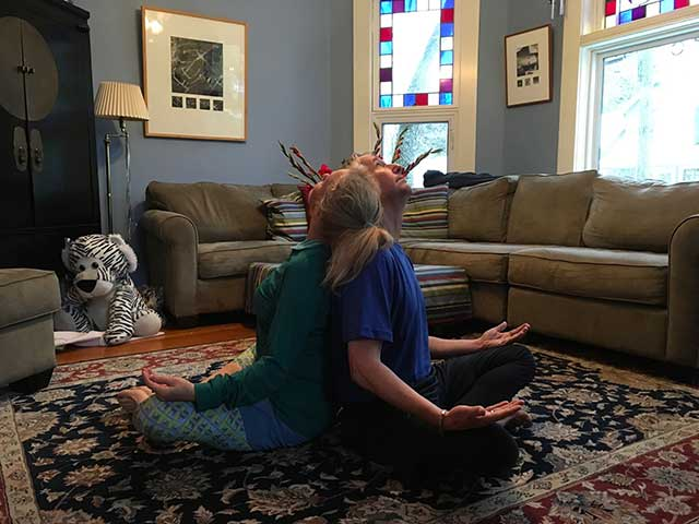 Image of partner yoga - neck stretch