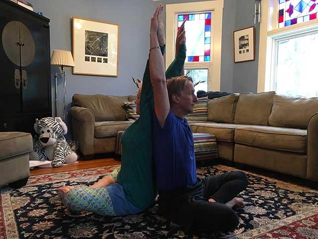 image of partner yoga shoulder chest stretch position 1