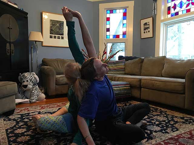 image of partner yoga shoulder chest stretch position 3