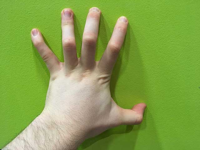Image of hands in a claw hands yoga strengthening position