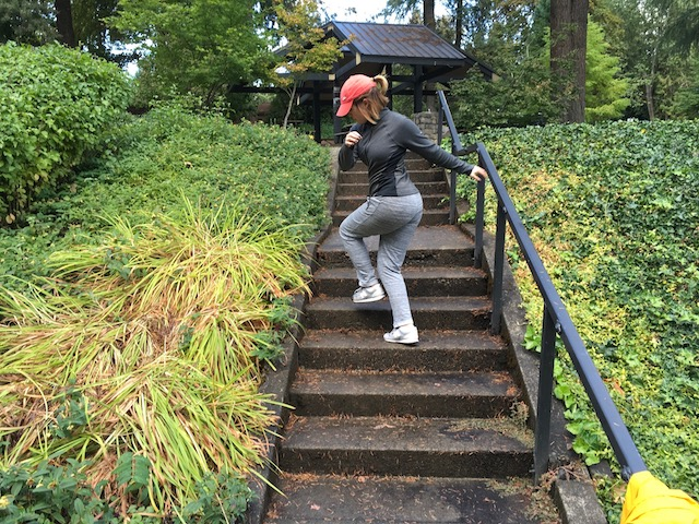 Image of woman doing karaoke stair exercise on stairs