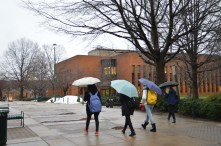 It was raining late Wednesday in Fairfax and these George Mason students were ready with their umbrellas to safely walk to class.