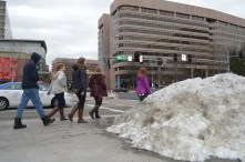 The snow still isn't completely gone in Crystal City and looks quite dirty and defeated. I liked seeing the height difference between this group of people and the mound of snow as well as the big boots they were all wearing.