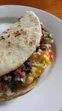 Fresh Flour Tortilla stuff with Scrambled Eggs, Black Beans, and Pico de Gallo