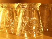 sunrise lighting the glasses on kitchen shelves
