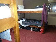 A tidy 4-dorm room at Pinewood Lodge.