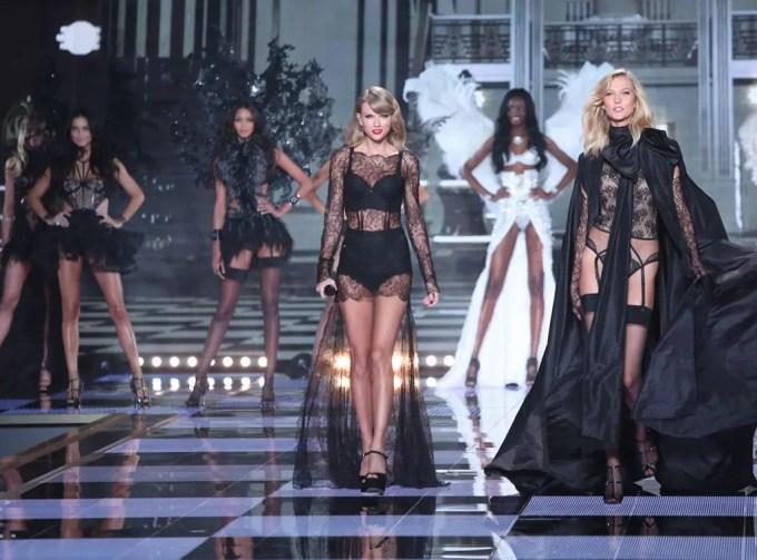 Taylor Swift and her bestie Karlie Kloss walking down the runway dressed in Black lingerie