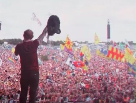 "Ed Sheeran performing to a massive crowd. Captured from the ""Photograph"" music video"