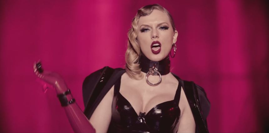 Taylor Swift wearing latex and holding a whip in LWYMMD video