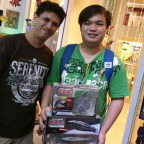 Winner of the X-Wing tournament, Ruben Lee (right) with Bruce of Atom Comics!