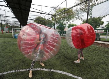 Two visitors play Bubble Bump at The Arena Open House.
