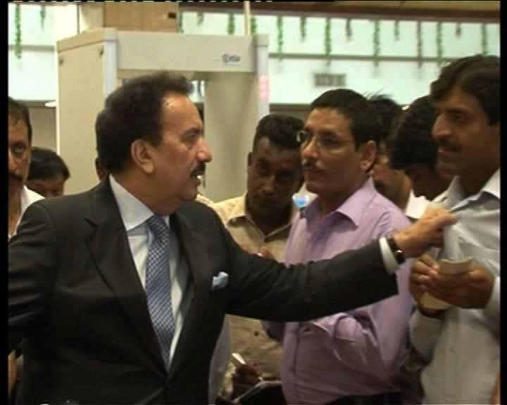 rehman malik holds the collar