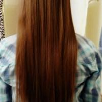 Virgin reddish brown - dark strawberry blonde straight vibrant hair.