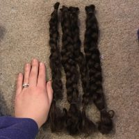 15 inches of virgin dark brown curly hair