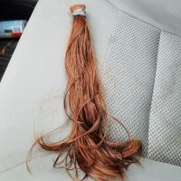 12 inches of red, wavy virgin hair
