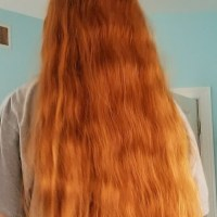 Virgin, long, thick, and wavy red hair for sale.