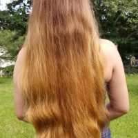 "20"" of thick light brown hair"