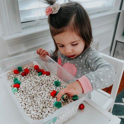 toddler using sensory bin