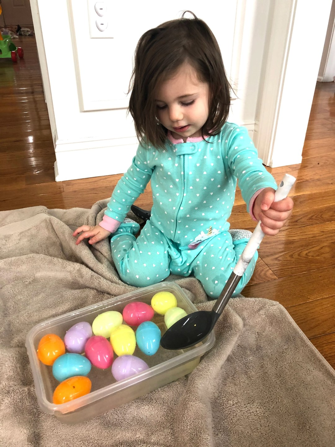 This is a simple and inexpensive Easter activity to do with your baby or toddler. It requires very little set up and common household items and addresses fine motor skills, language, and sensory play.