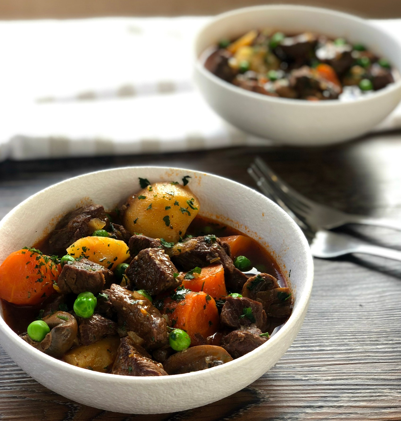 Bowls of Slow Cooker Beef Stew with veges