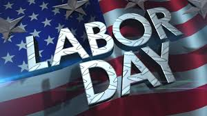 "The word ""Labor Day"" with a US flag in the background."