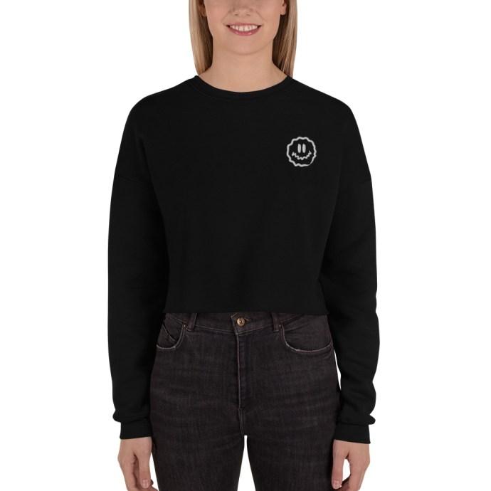 person wearing antsy face crop sweatshirt