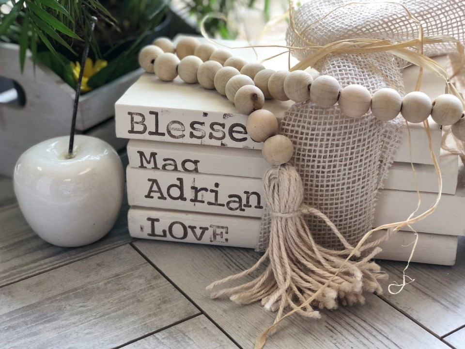 Learn how to make exceptional home decor accent. Stamped stack books. Wooden beads garland