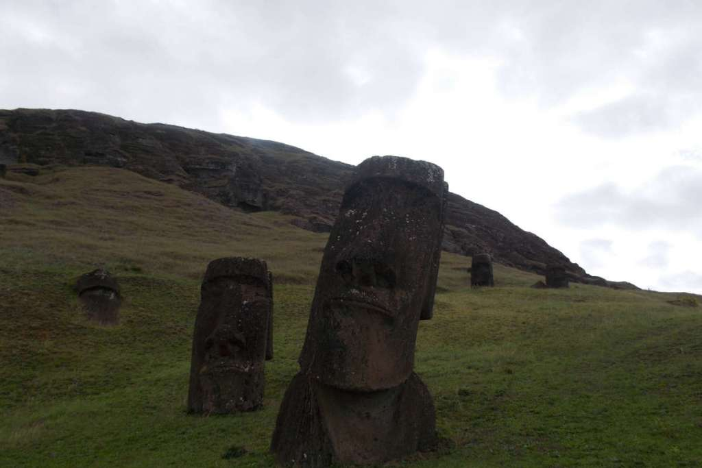 "Large Moai sticking out of the ground at the ""Moai factory"", Easter Island"