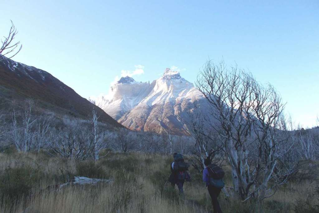 Hiking in Torres del Paine with mountains in the distance