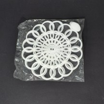 "Unopened pack of white, 6"", vintage Tupperware doilies"