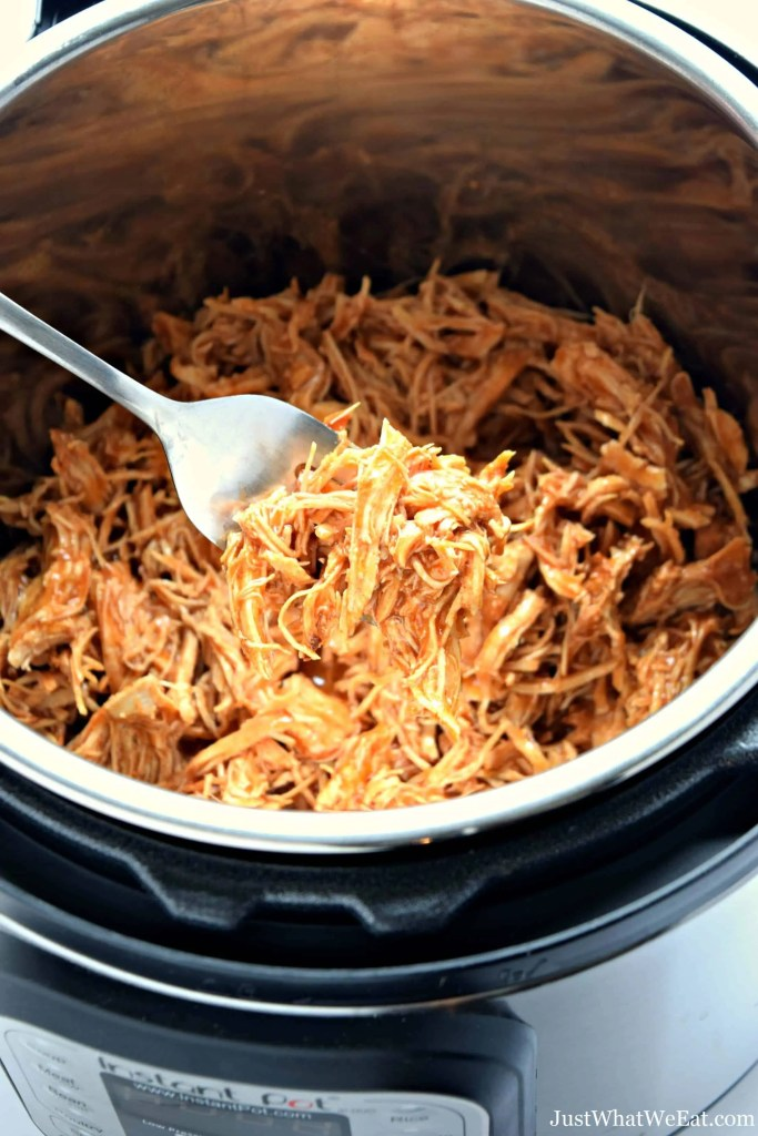 This shredded BBQ Chicken has so much flavor and can be enjoyed in so many different ways!! You can make this BBQ Chicken in the slow cooker or Instant Pot making it a super easy dinner option!