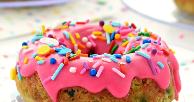 These Birthday Cake Donuts are an awesome way to celebrate any occasion! They are gluten free, vegan, dairy free, and taste delicious! They are also baked donuts making them a bit healthier than traditional fried donuts. #glutenfree #donuts #doughnuts #dairyfree #vegan #recipes #breakfast #dessert