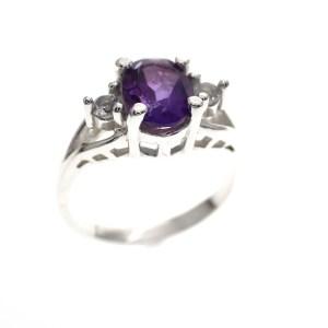 zilveren ring met paarse steen