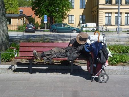 Drifter on park bench