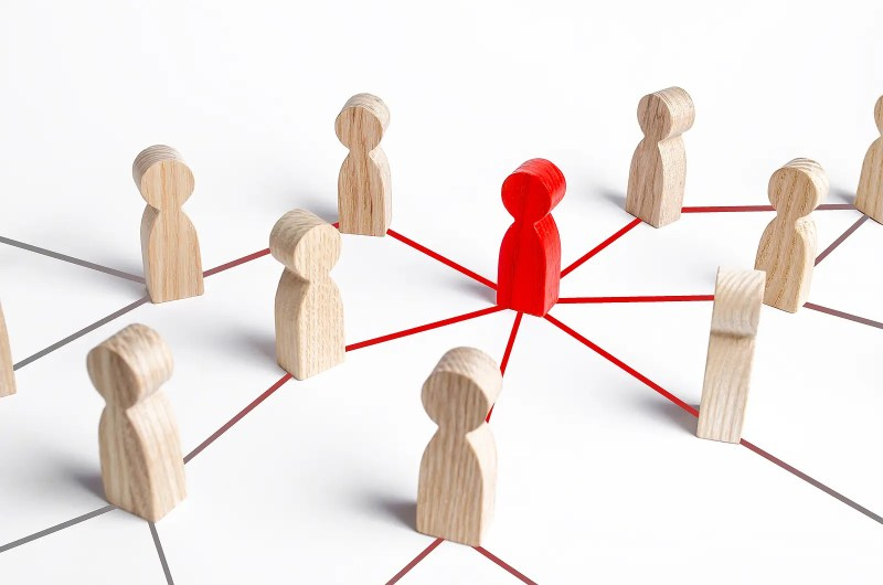 The red figure of a person spreads his influence to people by online reputation management