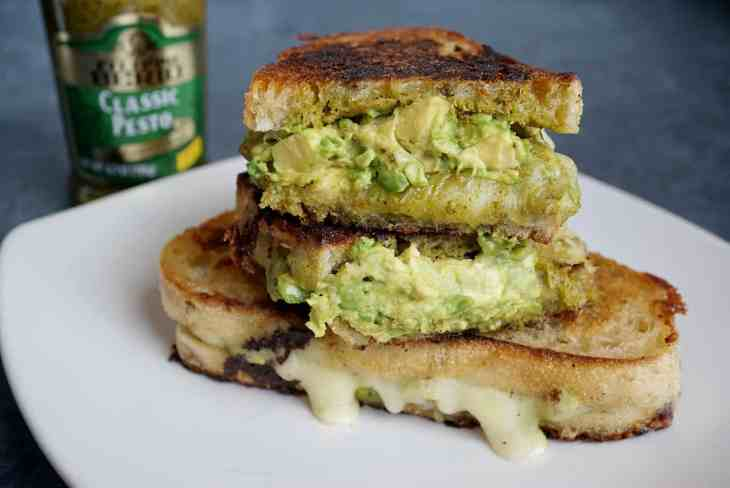 This Pesto Grilled Cheese is made with Filippo Berio Classic Pesto and stuffed with fresh avocado. It's a quick and easy weeknight dinner and sure to be a new favorite in your home.
