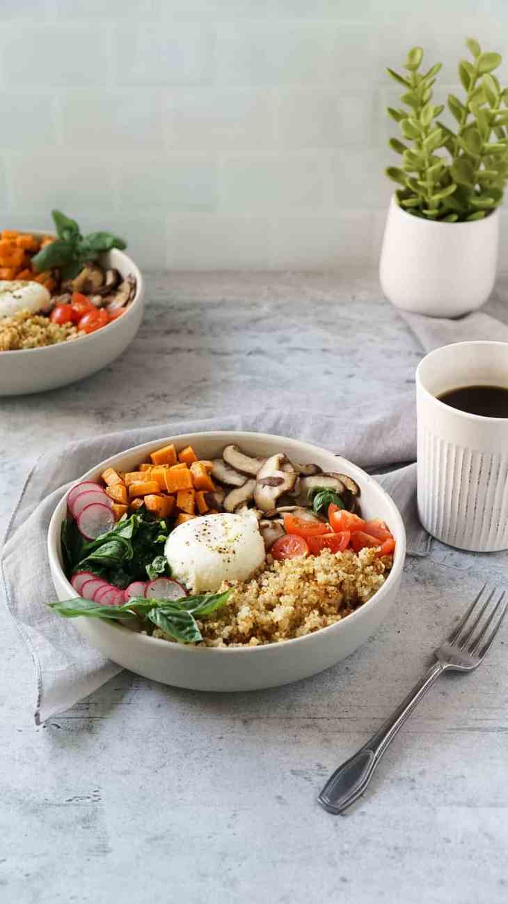 two quinoa breakfast bowls with a cup of coffee