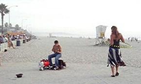 PB ocean walk musician & hula hooper