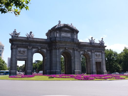 K in Motion Travel Blog. Shenanigans in Sunny Spain. Some Famous Gate in Madrid