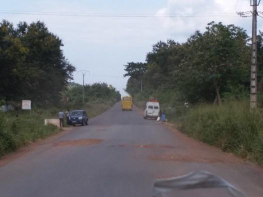 K in Motion Travel Blog. Cote d'Ivoire. Pot-holed Road