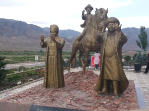 K in Motion Travel Blog. Eastern Kyrgyzstan. On the Way to Issyk-Kul. Welcoming Statues at Ak-Zhol