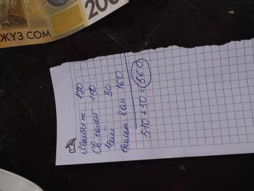 K in Motion Travel Blog. Eastern Kyrgyzstan. Bishkek. Kadji-Sai Town Near Issyk-Kul. Hand-Written Food Bill