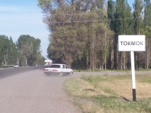 K in Motion Travel Blog. Eastern Kyrgyzstan. Tokmok Town Sign