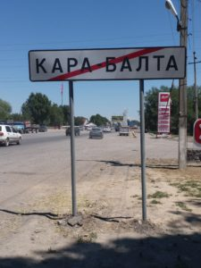 K in Motion Travel Blog. Silk Road to Southwestern Kyrgyzstan. Kara-Balta Town Sign