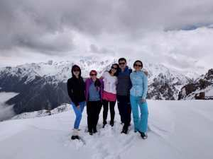 K in Motion Travel Blog. Almaty Kazakhstan. Tyan Shan Mountains.  Standing with Friends Near the Border With Kyrgyzstan