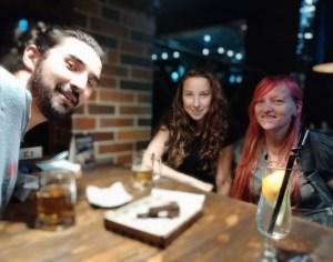 K in Motion Travel Blog. Underrated Uzbekistan. Mazid, Alina and I at Local Pub